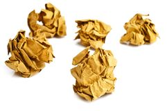Yellow crumpled paper balls on white Stock Image