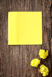Yellow crumpled papers put on wooden Royalty Free Stock Images
