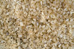 Yellow crystals of cane sugar Stock Images