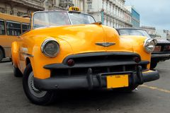 Yellow Cuban Taxi. Old yellow American taxi in Havana, Cuba Royalty Free Stock Photography
