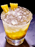 Yellow cube ice of cold drink  with  pineapple on Royalty Free Stock Photography