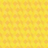 Yellow cubes on fabric pattern Stock Image