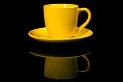 Yellow cup. Isolated on black stock image