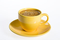 Yellow cup Stock Images