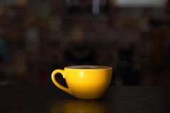 Yellow cup of cappuccino Stock Image