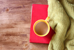 Yellow cup of coffe on old vintage books Royalty Free Stock Photos