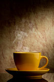 Yellow cup of coffee Royalty Free Stock Photos