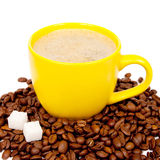 Yellow cup of coffee with beans Stock Image