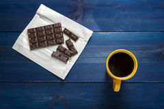 Yellow cup of coffee and chocolate Stock Image