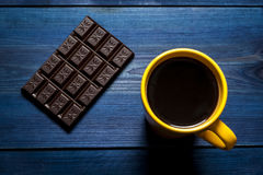 Yellow cup of coffee and chocolate Royalty Free Stock Photo