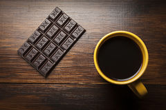 Yellow cup of coffee and chocolate Royalty Free Stock Image