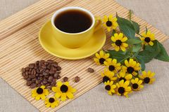 Yellow cup of coffee with Flowers Stock Photography