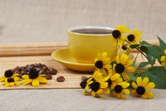 Yellow cup of coffee with Flowers Stock Photos