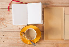 Yellow cup of coffee and note Royalty Free Stock Photo
