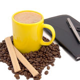 Yellow cup of coffee and notebook Stock Photography