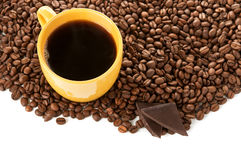Yellow cup of coffee and roasted beans Royalty Free Stock Images