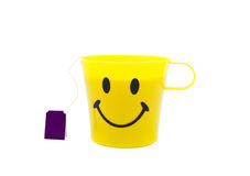 Yellow cup with drawing in a kind of smile Stock Photography