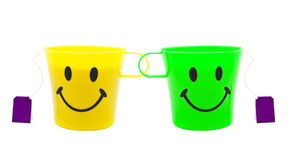 Yellow cup with drawing in a kind of smile Stock Images