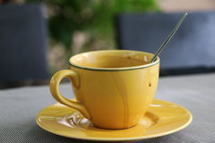 Yellow cup of hot drink Royalty Free Stock Image