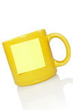 Yellow cup with note sticker Stock Photos