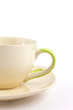 Yellow cup and saucer Royalty Free Stock Photos