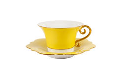 Yellow cup and saucer Royalty Free Stock Image
