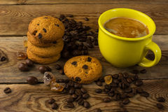 Yellow cup of strong coffee and cookies Royalty Free Stock Image