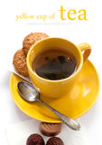 Yellow cup of tea. Royalty Free Stock Images