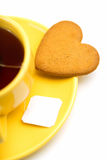 Yellow cup with tea bag and  cookie Stock Images