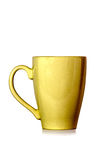 Yellow cup on white background Stock Images