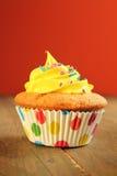 Yellow cupcake Stock Images