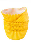Yellow cupcake baking cups. Yellow paper molds for cakes Royalty Free Stock Images