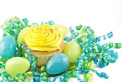 Yellow Cupcake with Easter Eggs and decorations Royalty Free Stock Images
