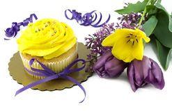Yellow Cupcake with Fresh Tulips Stock Photo