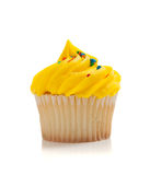 Yellow Cupcake with sprinkles on white Royalty Free Stock Photos