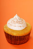 Yellow cupcake with vanilla frosting Stock Photos