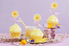 Yellow cupcakes. Decorated yellow cupcakes for a summer party or birthday stock photo