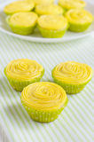 Yellow cupcakes in green paper baking cups Stock Photography