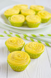 Yellow cupcakes and striped drinking straws Stock Photography