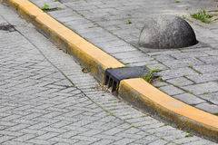 Yellow curb and obstacle Royalty Free Stock Image