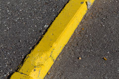 Yellow curb stone border Royalty Free Stock Photography