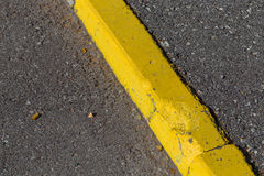 Yellow curb stone border Stock Photo