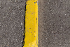 Yellow curb stone border Stock Images