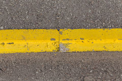 Yellow curb stone border Stock Image