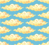 Yellow curly cartoon style clouds on blue background vector seamless pattern Royalty Free Stock Photos