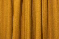 Yellow curtain. A background of a close up of a textured yellow curtain Stock Photography