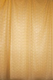 Yellow curtain. A close up of a textured yellow curtain Royalty Free Stock Photography