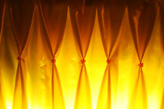 Yellow  curtain. Yellow  color   curtain   bright     with   beautiful   lighting Royalty Free Stock Image