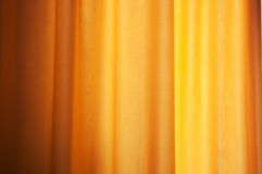 Yellow curtain as background. And texture Stock Photography