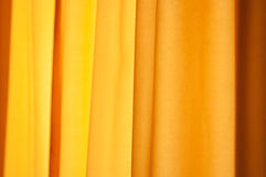 Yellow curtain as background Royalty Free Stock Images